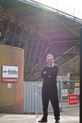 Jim Walsh standing proudly opposite the main entrance to firstsite's new building project