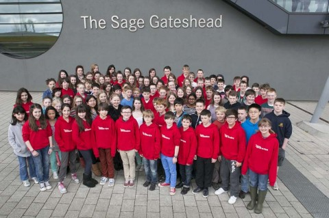 NYOS musicians posing in front of the Sage Gateshead