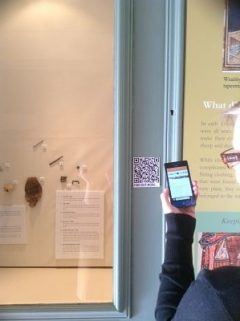 HLF Project Officer Gillian Ramsay excitedly tests out the QR-coded interactives in the archaeology exhibition: simple digital engagement will allow visitors to find out more, linking to the website for further information on the building and collections, including recorded lectures and educational podcasts.